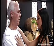 Young brunette seduces an old man