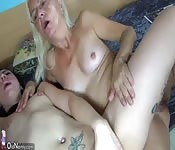 Blonde MILF and young brunette love munching each other out's Thumb
